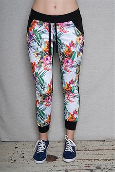 You gotta grab these crazy-cute colorblock black  white joggers The colorful island floral print of the white front is eye-catching amazing when framed against the black drawstring waistband ribbed cuffs and plain black back. Wear with a crop top for maximum awesomeness
