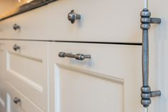 Painted shaker off white kitchen with rustic pewter handles. Off White Kitchens, Apartment Lighting, Real Kitchen, Shaker Kitchen, Real Wood, Light Decorations, Bold Colors, Pewter, Door Handles