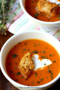 [ Recipe: Roasted Red Pepper Soup ] made with: red bell pepppers, olive oil, onion, small carrots, garlic, fresh thyme, white wine, chicken broth, potato, sugar, salt, pepper. For garnish: sour cream, garlic croutons, and fresh italian parsley ~ from Uni Homemaker
