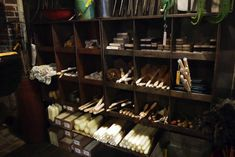 A range of household objects on display in wooden bins.