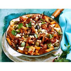 This quick and easy chorizo, mushrooms, olives and feta cheese penne pasta bake recipe is great for a quick and easy weeknight dinner idea.