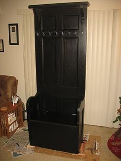 Repurposed door hall tree with hinged lid seat for storage.