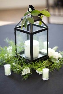 Lantern Centerpiece do on purple table cloth kumquats with candle in it