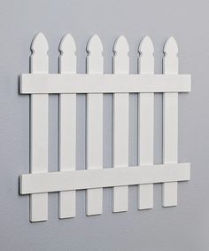 I have these all the way around Anna's room and shoved huge gerber daisies behind it - super cute! Take a look at this White Picket Fence by Heart to Heart on #zulily today!