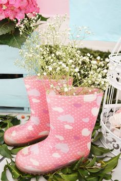 Maybe it's time to turn Eben's damaged rain boots into little planters...