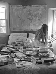 Books on a bed, too many to read, never enough, is it?