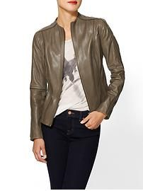 I love this understated neutral jacket with dark denim and a peek a boo top underneath.