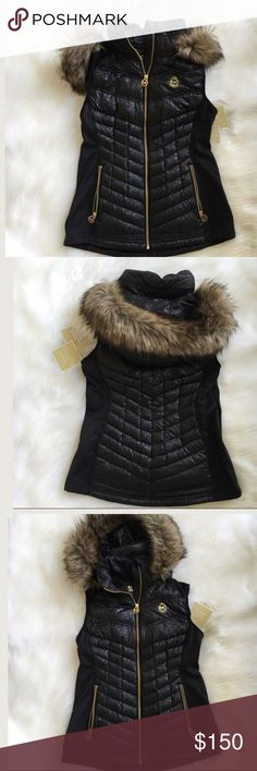 MiCHAEL KORS down vest Black Down Vest with a faint leopard print embossed in the material with a faux fur hood that is detachable by a zipper. New! Authentic trades Michael Kors Jackets & Coats Vests