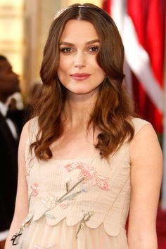 Keira Knightley's hairstylist, Ben Skervin for Fekkai, blow-dried twisted sections of hair to get tousled, not-too-done waves before adding a diamond Chanel headband on top to finish the look.    - HarpersBAZAAR.com