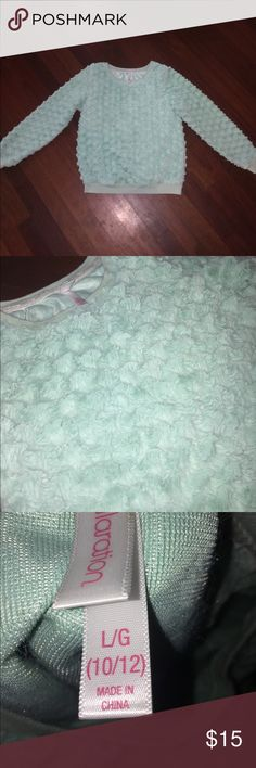 Fluffy sweater This sweater is from target never worn.Its very soft and great for the winter to keep warm!The color is turquoise. Xhilaration Sweaters