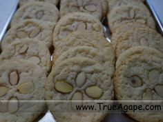 Luau food- Sand dollar cookies. Put sliced almonds on sugar cookies when they come out of the oven