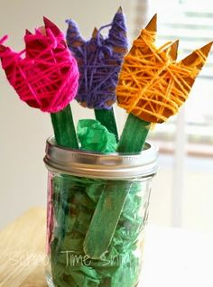 Beautiful Yarn Wrapped Spring Flowers Craft is part of Spring Flower crafts Yarn wrapped crafts are great for fine motor skills, easy to do, and are fun to make! Make a sweet spring bouquet of yarn - Kids Crafts, Spring Crafts For Kids, Toddler Crafts, Easter Crafts, Art For Kids, Arts And Crafts, Kid Art, Art Children, Family Crafts
