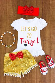 "This outfit is absolutely stunning! ""Let's Go to Target"" written on the front in gold and red glitter. Paired with matching gold sequin stretchy shorts.   Short"