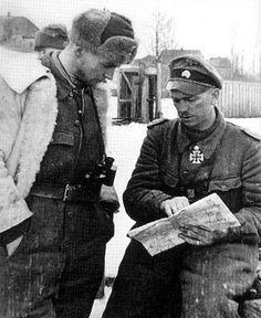Kurt Meyer and Max Wunsche,reading a map,..Kharkov,Russia,1941.