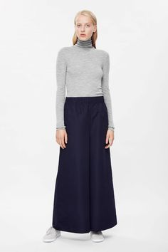 COS A/W 2015 These dark navy blue wide-leg trousers are made from lightweight technical fabric with a smooth, lightweight feel. Designed to sit high on the hips and flaring towards the hem, they have a dropped crotch, in-seam side pockets and a gathered elasticated waistband.