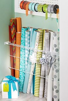 Use a section of wire shelving and a pair of plastic end brackets to create a simple rack for rolls of wrapping paper.