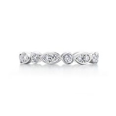 Tiffany Swing ring of diamonds in platinum.  This is the style I want for my wedding band to bad it's like 4,000!!!  I need to find something like it in white gold not platinum !!!