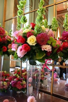 [hot+pink+and+lime+tall+wedding+centerpiece+Kuga+Designs.jpg]