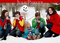 Love it!  Cute way for a family portrait, but not that cheesy staged-crap that I hate- FUN!! <3