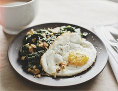 sunny eggs + mustard-creamed chard - nix the breadcrumbs and substitute with crispy bacon :)