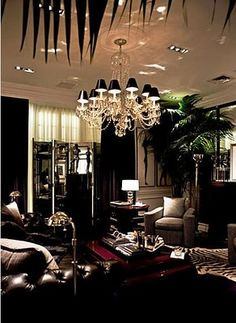 This could be the chandelier i've been looking for! I identify with the touches of red and green in the plant! Against the black white and gold scheme...perfect. Ralph Lauren Home boutique