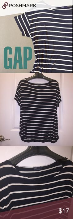 🎼s t r i p e d dolman top Like new! I wore a couple times. Striped Dolman sleeve top with rounded hem from GAP. Nice modest sleeve length (not cap sleeves). Navy blue and white. Size L. Check out my closet for more L/XL and 14/16 clothing. Bundles are only 2 items! Bundle and make an offer! GAP Tops Tees - Short Sleeve