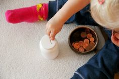 DIY activity: sticking coins in small slot (Eltern vom Mars: Montessori yourself!)