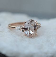Peach sapphire Rose gold engagement ring. Engagement ring by Eidelprecious. This is Campari design by Eidelprecious. The ring features a mesmerising 3.95ct oval sapphire. The color is gorgeous very light blush. It changes to clear or peach pink depending on the lightening. The sapphire is very
