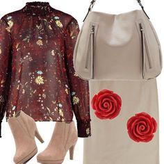 Fiori nella camicia e negli orecchini, da abbinare alla gonna tubino color ghiaccio e alla shopping bag dello stesso colore, un paio di stiletti color beige e l'outit è completo!