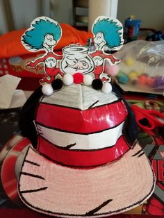 Crazy hat day. Old hat, white fabric paint, duct tape, blavk sharpie, cutouts laminated, pom pom, and a piece of cardboard to hold up thing 1 thing 2 and carlos