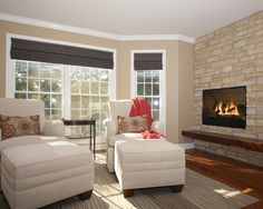 Fireplace, Transitional Family Room With Exquisite Fireplace Facelift Also Beige Bricks Stone Fire Surround Also Brown Wooden Mantelpiece And Elegant White Padded Armchairs And Footstools Also Cream Wall Paint Color: Simple and Beautiful Fireplace Facelift