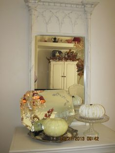 View from the little side table.  The table used to be oak, and the mirror was an estate find for $7.00.  I painted them the same color-Behr cottage white.  The vintage etched frameless mirror, crystal cake plate from my collection.