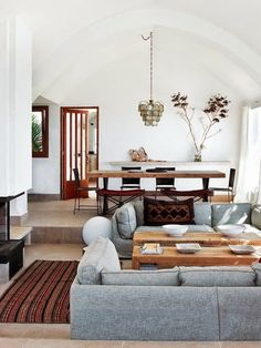 Lounge / Living Room / Grey / Gray Sofa Bohemian / Antique Rug / Vintage / White Walls / Rustic Wood Dining Table / Rustic Wood Coffee Tables