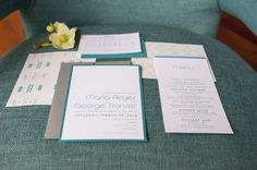 A teal and white wedding invitation suite for a tropical wedding session.   Candy Acosta Photography