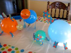 Dinosaur balloons - centre pieces that we just love www.rockpapersticker.co.uk