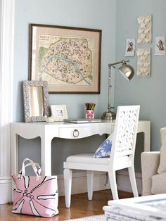 Duly Noted  A slim desk in a corner of the living room gives the homeowners a place to work while the kids play. Crisp white paint and modern lines on the desk and chair bring the area into style alignment with the rest of the rehabbed room.