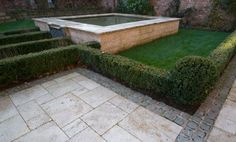 The Garden area is luxuriously paved in honed travertine which also forms the fish pond and fountain as well as the steps allowing the kitchen to open on to the garden. The travertine paving is accented with contrasting edge detail using jet black granite block setts.