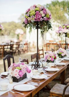 The reception had even more one-of-a-kind touches in store, place settings featured mismatched vintage china and the tables were studded with a charmingly eclectic array of chairs.