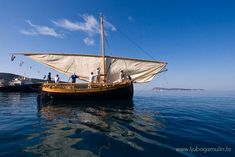 "Raising lateen sail on Croatian traditional sailboat bracera ""Our Lady of the Sea"""