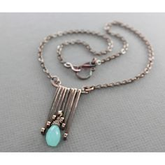 Art Deco design copper necklace with cascading bars and mint color chalcedony stone