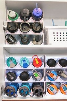 home organization Water Bottle Storage solution! How to organized kitchen cabinets with quick five minute organizing projects. Perfect kitchen cabinet organizers for water bottles, plastic cups, straws, and more.