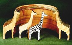 From the Ore Mountains toy museum Seiffen - a giraffe ring animal from the ring to the carved giraffe to the final painted animal.  Pinned by www.mygrowingtraditions.com
