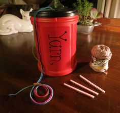 Re-purposed plastic coffee can into a yarn dispenser