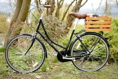 It's just a craft crate on a bike, but it looks so fancy. WANT! Wood Bike Basket by MacphersonCrateCo on Etsy, $69.00