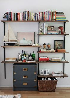 45 DIY bookshelves to inspire your next home project. Make your own homemade bookshelf from a single shelf or bookcase. This DIY is added storage or stylish display for books and home decor accessories. For more weekend DIY ideas go to Domino. Diy Industrial Bookshelf, Diy Bookshelf Plans, Bookcase, Industrial Bedroom, Industrial Office, Industrial Furniture, Homemade Bookshelves, Dyi Bookshelves, Regal Industrial