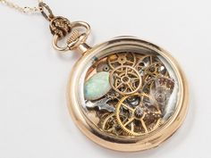 Steampunk jewelry Steampunk Necklace 14k gold filled Pocket watch movement case gears silver butterfly Opal Pendant Statement