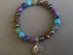 Chakra Gemstone Bracelet/ Gemstone Stretch Bracelet with Chakra Colors/ Yoga Bracelet with Silver Om Charm by PowerstoneJewelry1 on Etsy
