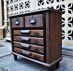 Well aged chest of drawers with 4 [strip file] drawers. Additions consist of 2 pressed Australian pennies, two English imported cast pulls, 4 wooden desk pulls, also oak pediment. Wooden Desk, Buffet, Drawers, Cabinet, Antiques, Storage, Furniture, Home Decor, Wood Desk