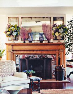 Mantelpiece with Seashell Mosaic: In the living room, the mantelpiece fire surround is a mosaic of seashells from Laurent Ribis, Paris. Amethyst vases from John Rosselli are flanked by pink sea fans from Ruzzetti & Gow. Classic seaside house once owned by Gloria Vanderbilt.