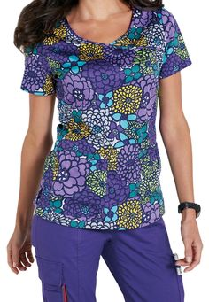 A flourishing flower print is the highlight of the In Bloom crossover print scrub top from the Beyond Scrubs collection. A subtle mock wrap and soft, stretch material give you the ultimate comfort throughout your workday, while two elastic-trimmed front pockets provide plenty of room to stash essentials.